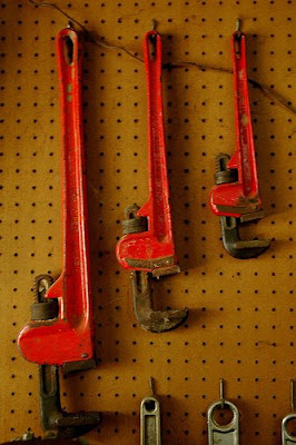 wrenches hanging from pegboard