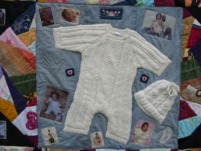 quilt incorporating whole baby clothes - onesie and hat