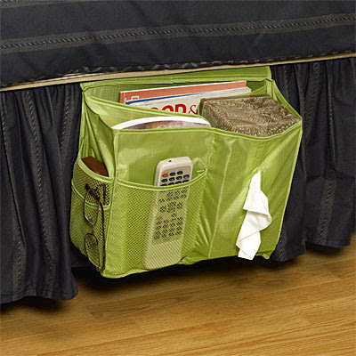 green bedside caddy with Kleenex box, remote, magazines, eyeglasses