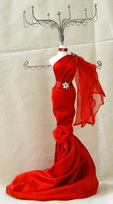jewelry mannequin in red off-the-shoulder evening gown