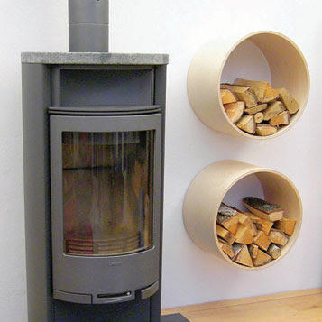 two wall-mounted firewood storage racks, next to fireplace