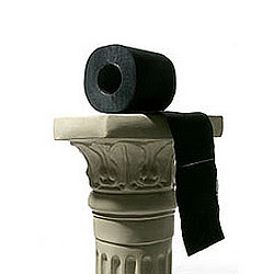 black toilet paper on pedestal