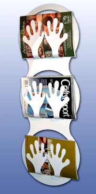 hand-shaped wall magazine rack