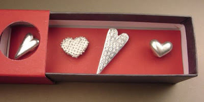 four pewter heart magnets