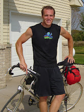 Me with my bike at the tail end of two-day ride. Note the sunburn and dishelveled appearance.