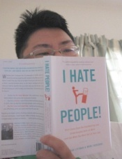 "Me, holding a copy of ""I Hate People!"" Not plotting anything with it"