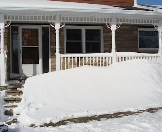 Snow drift in front of house