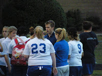 Coach Corsbie instructs the Lady Trojans