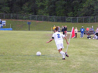 Meagan Proper connects with Paige Dugal on the corner kick