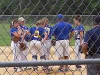Coach Barbour huddles at the mound