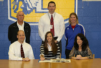 Garner's Paige Dugal flanked by parents Tre and Wendy Dugal, CASL Coach Rusty Scarborough, Ass't Principal Drew Cook and Head Coach Connie Barnes (picture courtesy of The Garner Citizen News-Times)