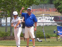 Coach Harris signals for courtesy runner for Kimmie Stewart who was hit by a pitch