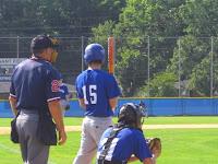 CJ Schmitt checks the with Third base Coach Pake