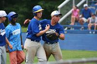 Alec Hulmes greeted after his game tying homer