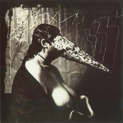 1979-Woman_breast_feeding_an_ael
