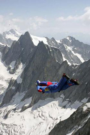a man base jumping in the mountains