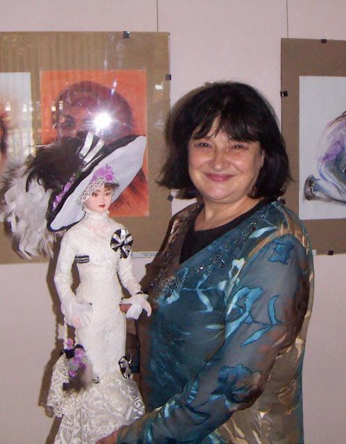 Natalia Basarab, Ukraine, holding a doll of Audrey Hepburn