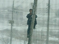 Korea Telecom Serviceman Installing DSL Service during February 2005 Snowfall in rural Kangwon Province
