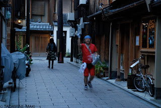 A man delivering newspapers at Gion, in Kyoto