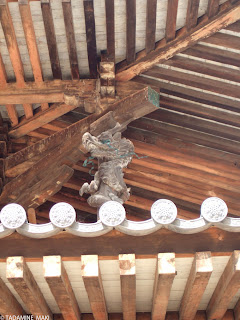 A dragon, supporting the roof, in Horyuji Temple