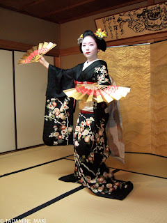 Maiko 4, dancing with decorative paper fans, Gion, Kyoto