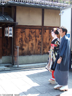 A maiko and a man in Gion, Kyoto
