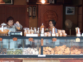 Women selling rice crackers, senbei in Japanese, in Kyoto