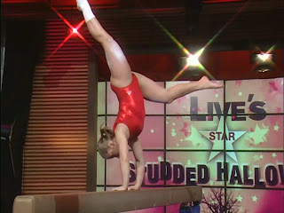 young gymnast spread legs