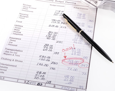 free stock photo of the household budget, with a red circle around gasoline costs, and an ink pen, copyright J. Gracey Stinson