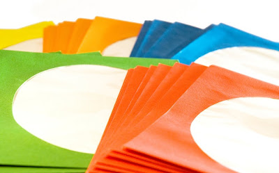 colourful CD storage sleeves with clear cellophane windows, copyright J. Gracey Stinson