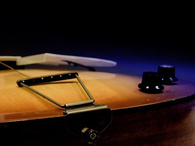 free photo of an old guitar - artistic representation from the bottom end