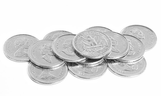 free stock photo of quarters in both canadian and american formats, isolated on a white background
