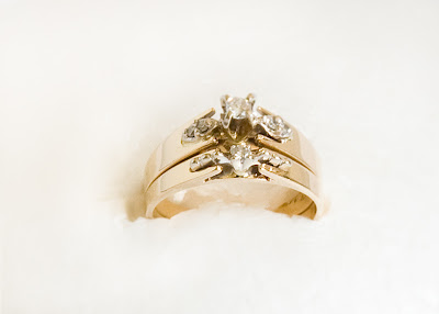 gold wedding ring and engagement ring with single diamonds in both rings