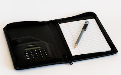 a zippered planner with a calculator and lined notepad