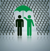 green man shielding black man under umbrella
