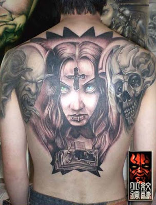 Portrait demon and skull tattoo on the back