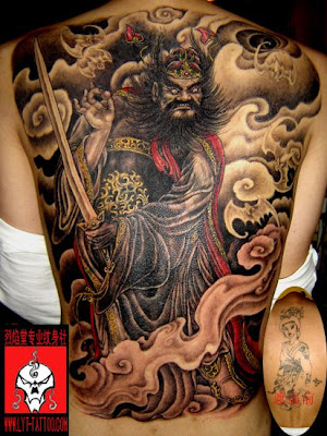 Full back portrait tattoo showing a a figure of Chinese mythology,