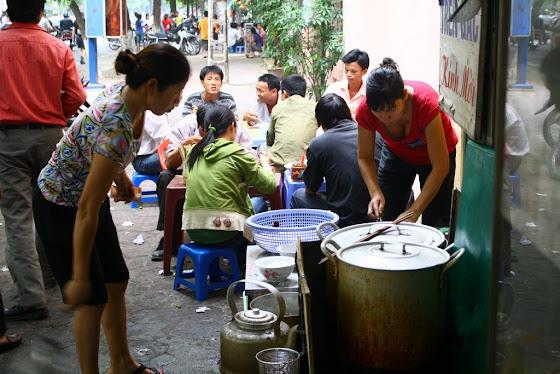 Personas del mercado en Hanoi