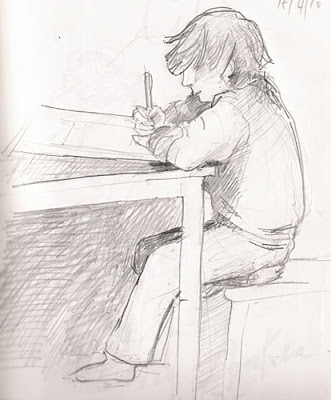 pencil drawing of a boy drawing