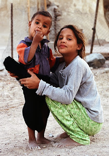 Photo: Bedouin boy and Bedouin girl posing, smiling