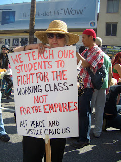 "Photo: sign saying, ""We teach our students to fight for the working class, not for the empires"""