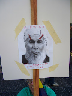 "Photo: sign with Bush with a turban and devil's horns, saying, ""El Diablo; Osama Bush Laden, terrorista #1"""