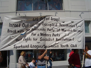 "Photo: sign saying, ""U.S. Out of Iraq! Israel Out of the Occupied Territories! Break with the Democratic Party of War and Racism- For a Workers Party that fights for Socialist Revolution!"""