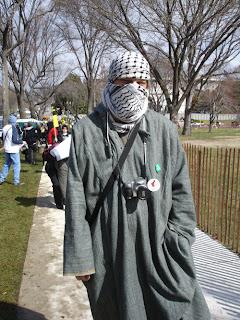 Photo: demonstrator in full Arab garb, including the kefiyyeh