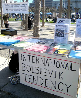 "Photo: a stand with the label, ""International Bolshevik Tendency"", with leaflets commemorating the 1917 Russian Revolution"