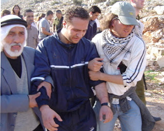 "Photo: a keffiyeh-wearing estranged Jew helping ""Palestinians"" in a demonstration against the IDF"