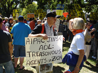 "Photo: Leftist demonstrator holding a sign that says, ""AIPAC, JINSA, ADL: Treasonous Agents of Zion"""