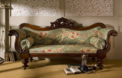Antique settee upholstered by Wheathills in William Morris Fabric