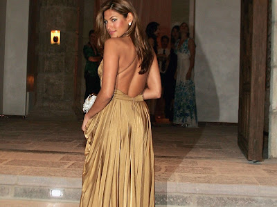 Eva Mendes in a gold dress