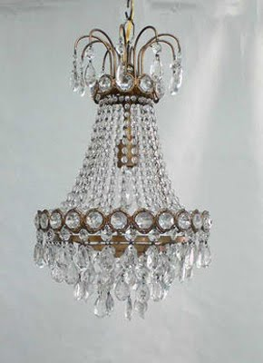 Traditional chandelier made of crystal and brass from Maison Luxe